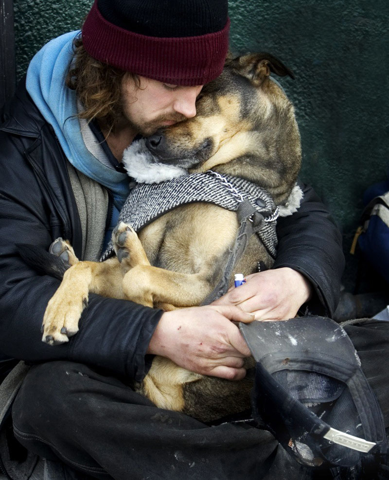 homeless man with his dog, picture speaks a thousand words,