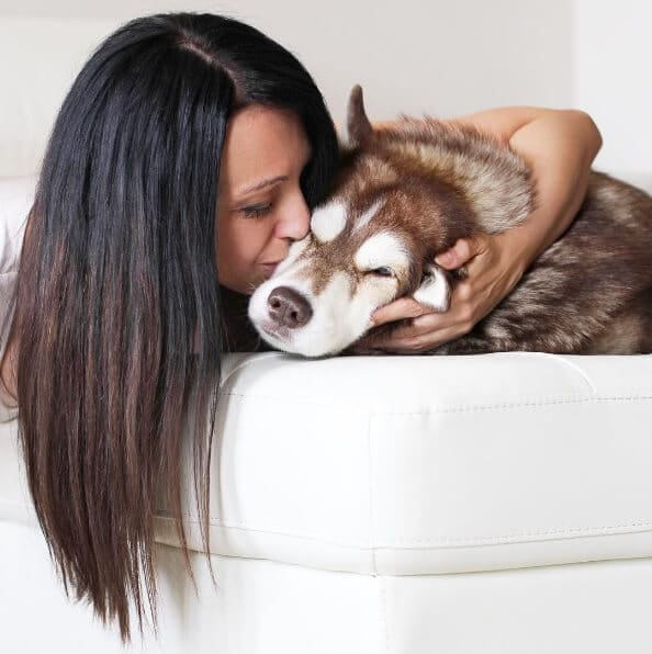 woman kiss dog